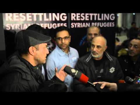 The Canadian Press - Two Families of Syrian Refugees Arrive in Toronto and Thank Canada