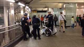 NYPD T3 TRANSPORTER SCOOTER UNIT PATROLLING THE VAST SUBWAY SYSTEM IN MANHATTAN, NEW YORK CITY.
