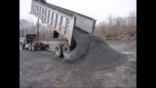 Dumptruck Dumping a Load Of Gravel