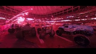 Jump ramps and kick up mud in a Monster Jam truck: 360 video