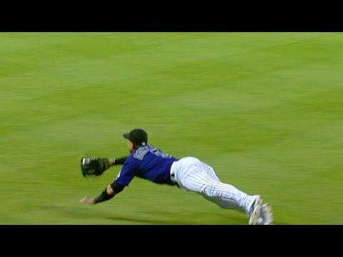 Gonzalez makes a diving grab to rob Kozma