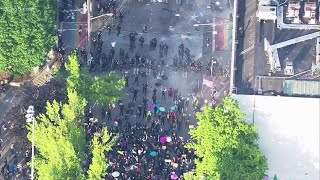 Seattle police clash with protesters in Capitol Hill as they try to disperse the crowd