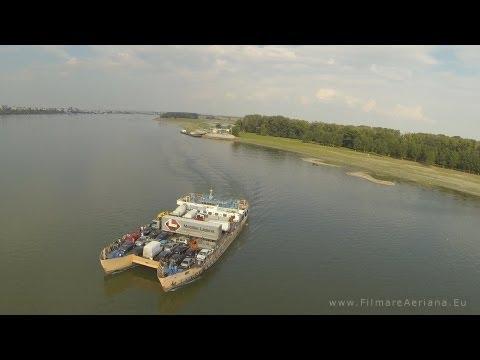 Multirotor drone crossing Danube following a ferry and landing on it