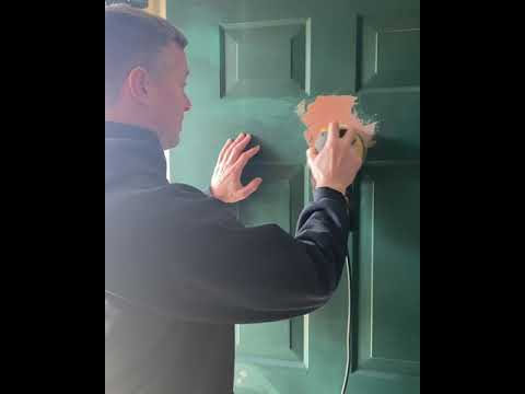 Fixing dents in a metal door