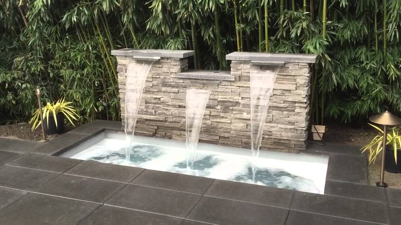 Modern spillway water feature - YouTube on Modern Backyard Water Feature id=46958