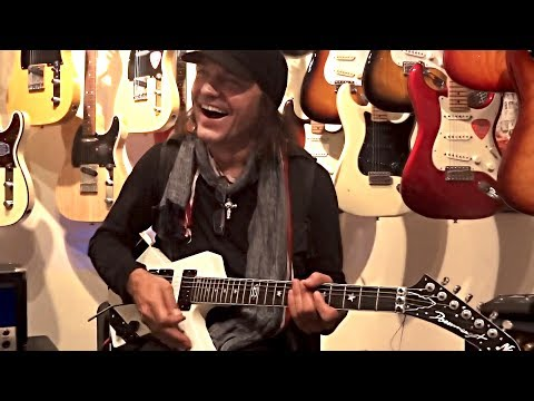 Matthias Jabs Playing In A Guitar Shop