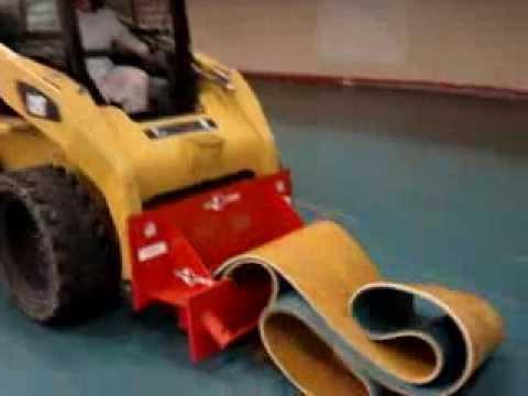 Skid Steer Scraper Attachment Removing Rubber Flooring
