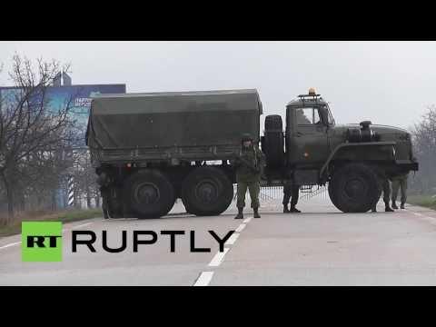 Ukraine: Unknown, heavily armed men patrol Sevastopol International Airport