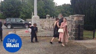 Peter Dinklage waves as he arrives for Millie Mackintosh's wedding