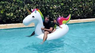 Kids Pretend Play with Giant Magic Unicorn Inflatable Water Toy in the Pool Funny Video for Children