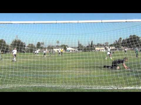 Goalkeeper Shawn Mallen low diving save to the far post 9.14.2013