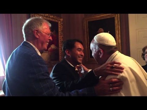 Pope Francis meets with, hugs same-sex couple