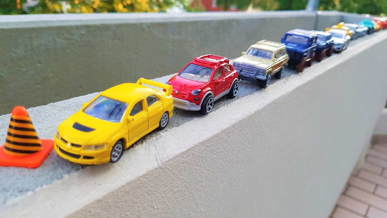 Driving cars by hand on the balcony wall 'Small Cars'
