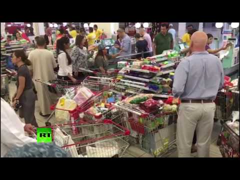 RAW: Qataris rush to stock up on food ahead of price hike