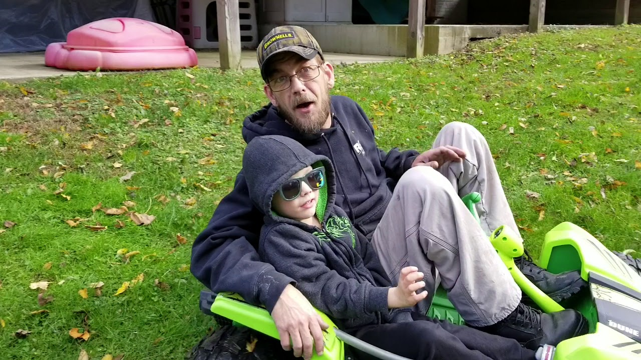grandpa and grandson off-road in the back yard