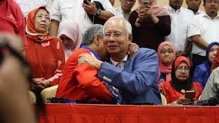 Najib steps down as Umno, Barisan chief