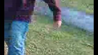Arsalan pissing in a park