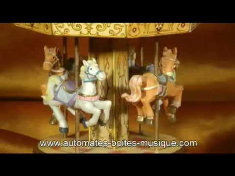 Miniature musical carousel made of wood
