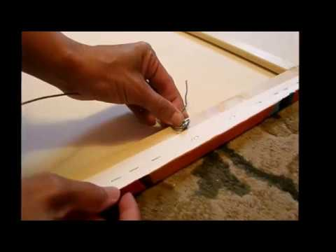 How to attach a wire hanger to the back of a canvas or frame