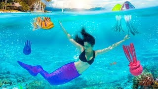 Mermaid trying Crazy Pool Toys Underwater