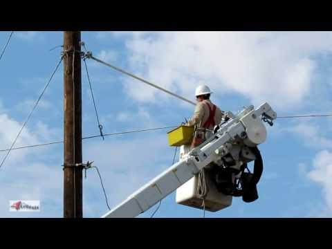 Electrical Linemen Working on Power Lines, Route 66