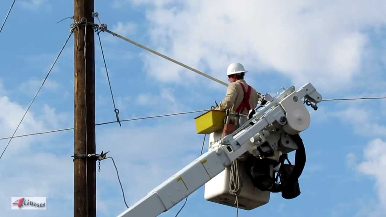 Electrical Linemen Working On Power Lines Route 66