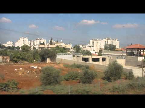 Lod 2015 (Israel) - St. Peter and St. George probably would not recognize the city today.