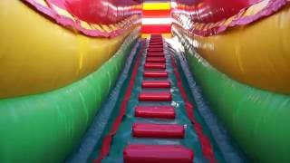 POV of 24' tall double lane inflatable slide