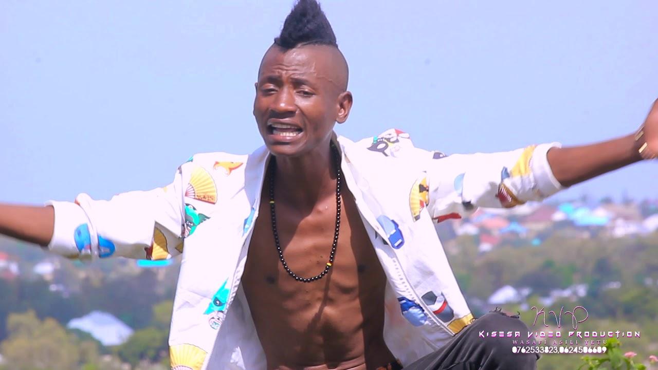 Download Mjukuu wa Mwanamalundi,,Bagikulo na Banamhala Official Video HD(Director D-Frank)