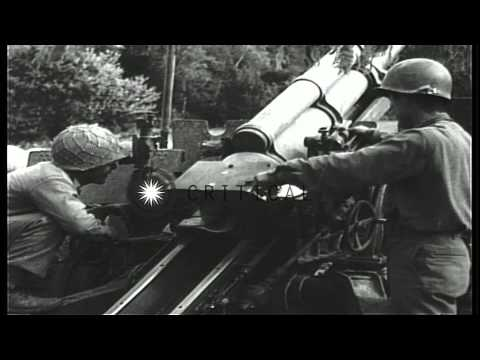 Japanese-American soldiers load and fire a 105 mm howitzer in France, during Worl...HD Stock Footage