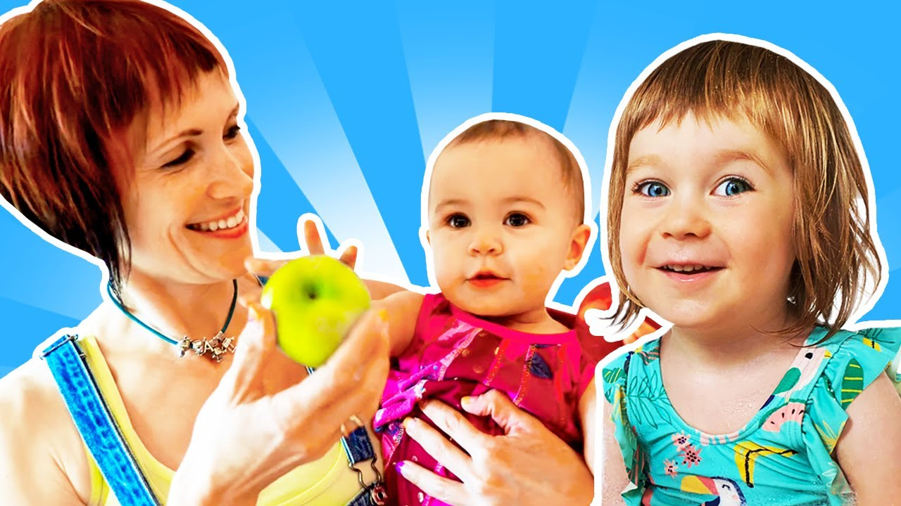 Baby girls on a playground - Kids play dolls & Family fun video.