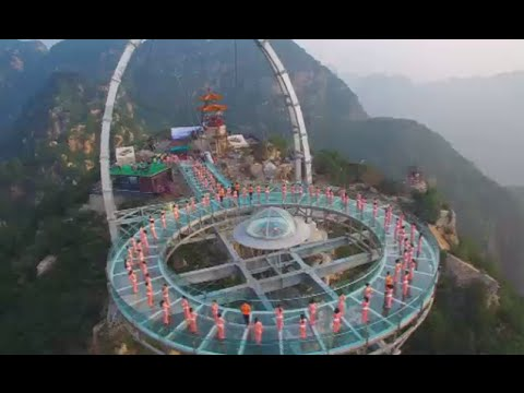 High Performance: Yoga fans practice on 400 meters glass platform in China (drone footage)