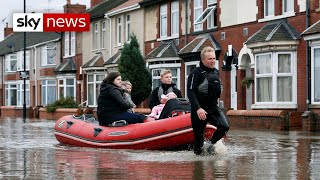 Woman dies after torrential rainfall hits the UK