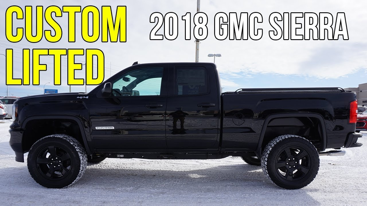 custom lifted  gmc sierras  leveling kit  body lift magnaflow mcnaught customs