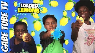 Top Toys LOADED LEMONS WATER GAME CHALLENGE!!! Gabe Tube TV