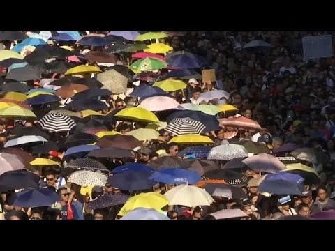 Thousands of people in Hong Kong protested the jailing of three pro-democracy leaders