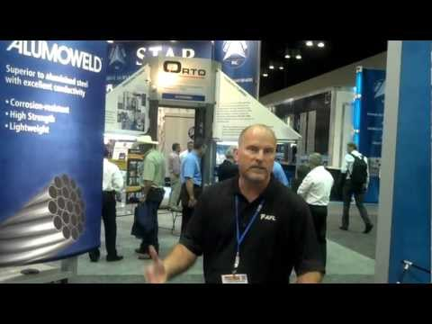 Steve offers a tour of our booth at IEEE PES T&D show in Orlando