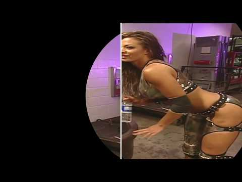 WWE Diva Candice Michelle Refreshes Herself With A Bottle Of Water