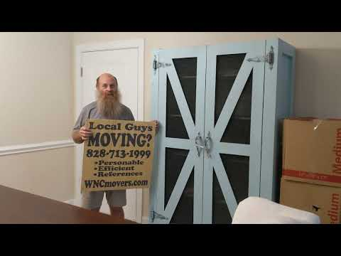 asheville-local-movers-unloading-pods-at-the-groves-at-town-center-apartments-in-fletcher-nc