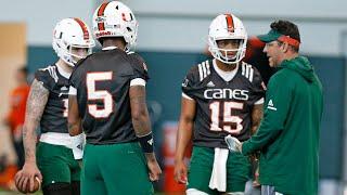 Canes offensive coordinator Dan Enos instructs Hurricanes quarterbacks