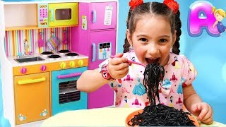 Anna is waiting for guests and cooking Black Noodle in a small toy kitchen