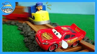 disney cars Lightning McQueen stuck in a railroad track. rescue McQueen.