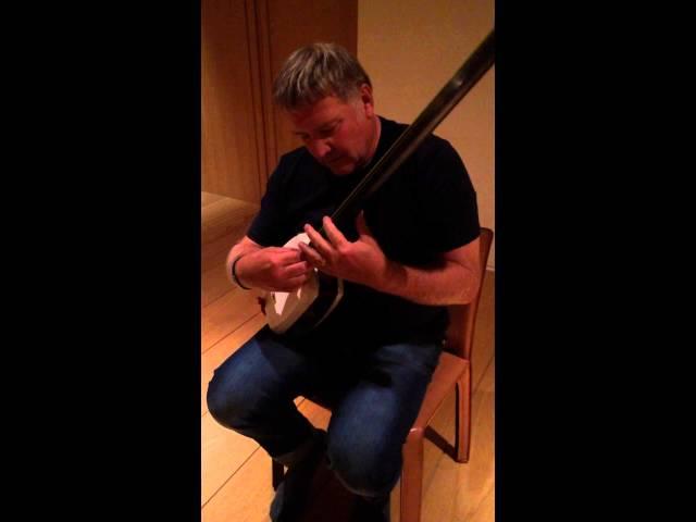 Alex Lifeson in Tokyo Japan tries a Tsugaru Shamisen