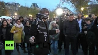 'Do you trust me?' Paris attack mourners hug blindfolded Muslim