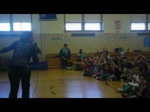 Kim B. performs at Dieterich Elementary School