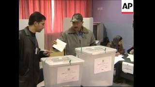 Polls open, voting begins, streets scenes and security
