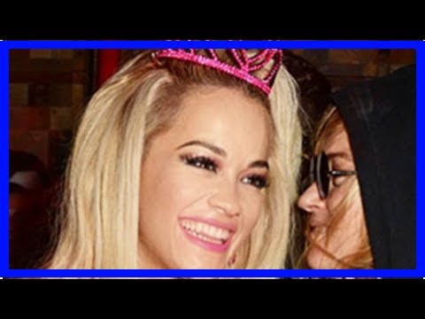 Rita ora goes knickerless in doll dress – and reveals intimate tattoo