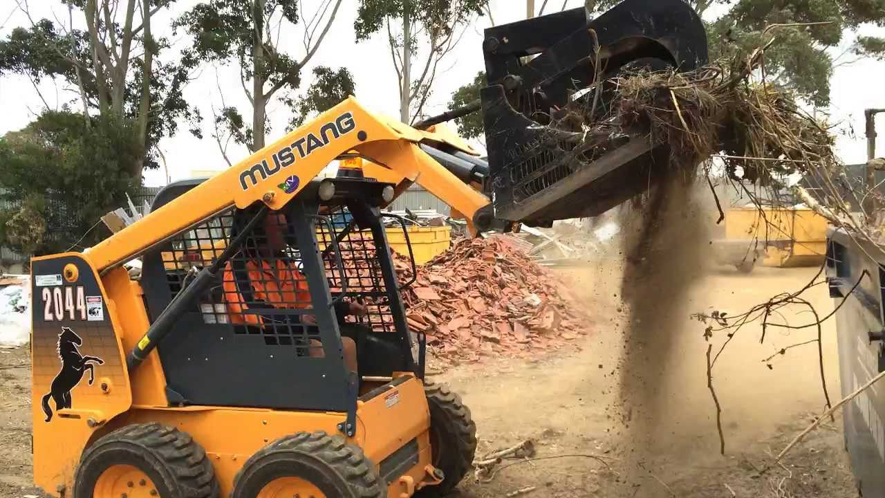 Skid Steer Rock Grapple Bucket Himac Attachments Youtube