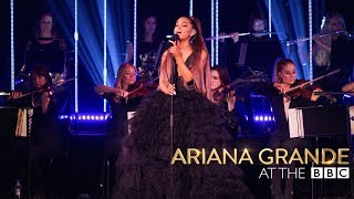 In an exclusive performance Ariana Grande is accompanied by an all-...