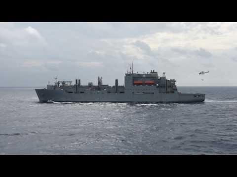 USS Carl Vinson (CVN 70) takes on ammunition